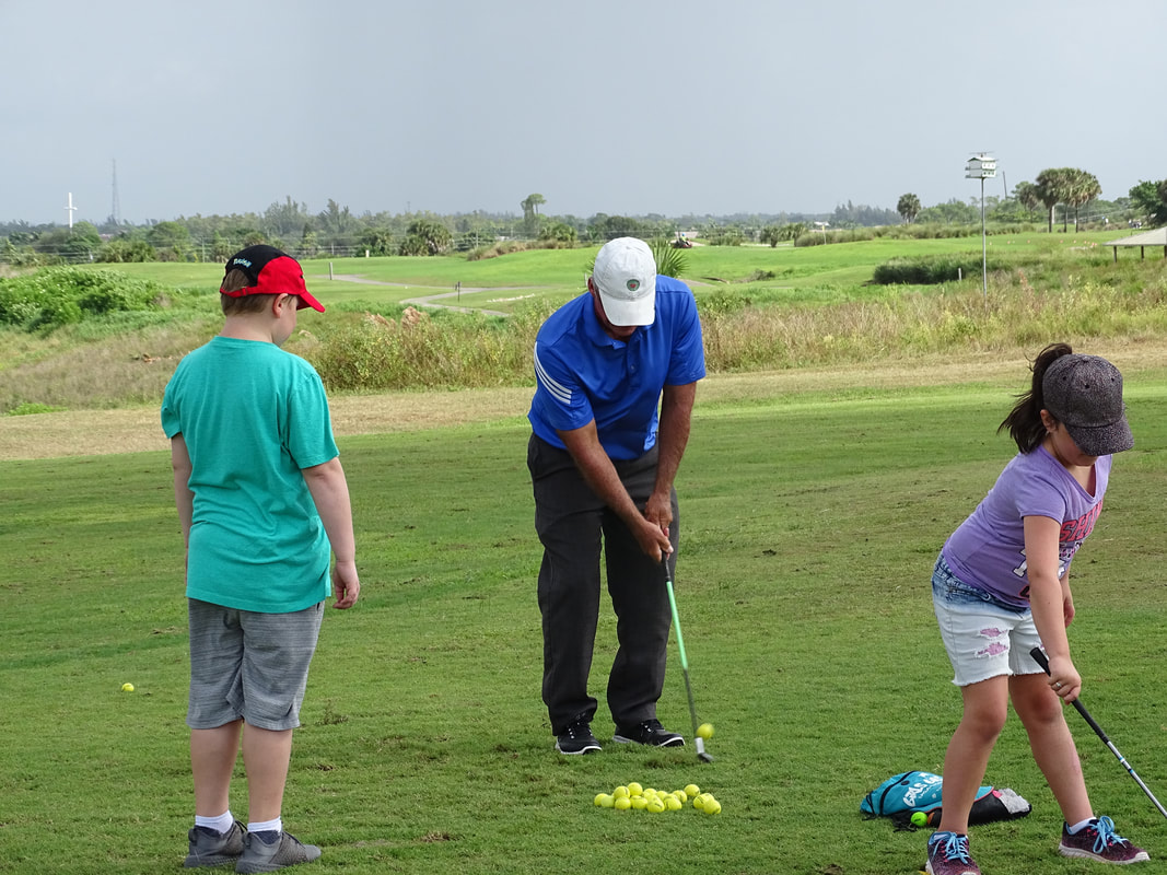 Glen Beaver demonstrates golf technique at Okeeheelee